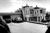 Torun, Poland.August 1997.This vulgar house was painted bright pink and had two big German made cars parked in its' driveway. For several meters around this house, in every direction, marijuana plants grew in the open..