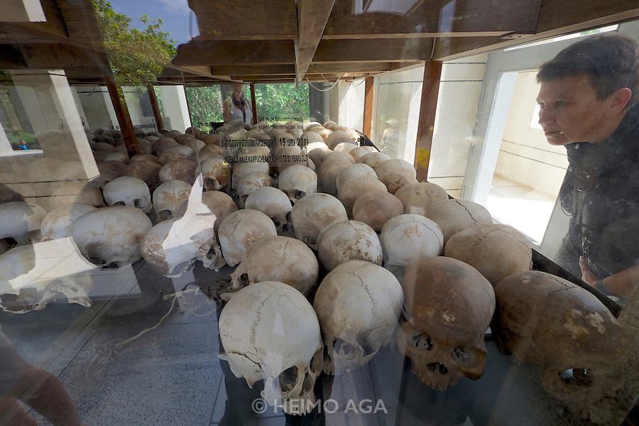 Phnom Penh, Cambodia. Choeung Ek Killing Fields memorial site, a reminder of the genocide committed by the Khmer Rouge.<br /> Commemorative stupa filled with skulls of some of the victims.