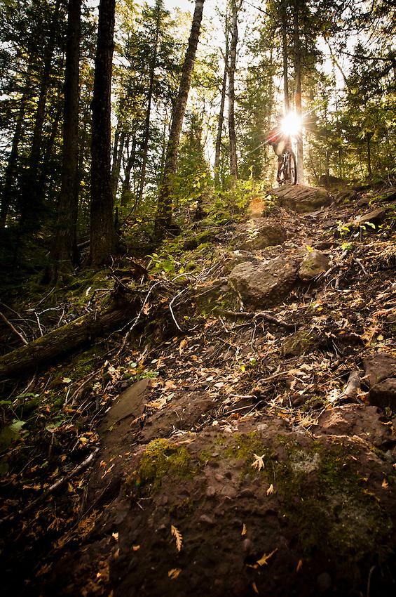 Riding a technical section of downhill trail while mountain biking in Copper Harbor Michigan Michigan's Upper Peninsula.