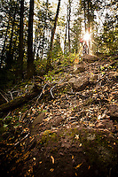 Riding a technical section of downhill trail while mountain biking in Copper Harbor Michigan Michigan's Upper Peninsula.