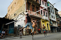 Cuban boys play volleyball at the dusk on the street of Havana, Cuba, 14 August 2008. About 50 years after the national rebellion, led by Fidel Castro, and adopting the communist ideology shortly after the victory, the Caribbean island of Cuba is the only country in Americas having the communist political system. Although the Cuban state-controlled economy has never been developed enough to allow Cubans living in social conditions similar to the US or to Europe, mostly middle-age and older Cubans still support the Castro Brothers' regime and the idea of the Cuban Revolution. Since the 1990s Cuba struggles with chronic economic crisis and mainly young Cubans call for the economic changes.