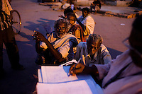 Homeless people line up to see the doctor at the mobile clinic in Jama Masjid on 4th October 2010, in Old Delhi, India. Picture: Suzanne Lee for The Australian.