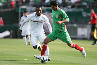 Jonny Magallon (2) dribbles the ball against Armando Collado (4). Mexico defeated Nicaragua 2-0 during the First Round of the 2009 CONCACAF Gold Cup at the Oakland, Coliseum in Oakland, California on July 5, 2009.