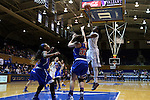 19 December 2014: Duke's Elizabeth Williams (1) shoots over UMass Lowell's Lauren Parra (32) and Shannon Samuels (13). The Duke University Blue Devils hosted the University of Massachusetts Lowell River Hawks at Cameron Indoor Stadium in Durham, North Carolina in a 2014-15 NCAA Division I Women's Basketball game. Duke won the game 95-48.