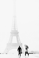 Paris, France --- Man and Woman Walking near Eiffel Tower --- Image by &copy; Owen Franken/CORBIS