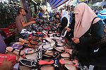 Palestinians shop at market during the preparation for the Eid al-Adha festival in Gaza, Sept. 30, 2014. Muslims worldwide are celebrating Eid al-Adha, or Feast of the Sacrifice, commemorating God's provision of a ram to substitute for Abraham's impending sacrifice of his son, where able Muslims offer either a goat, sheep, cow, buffalo, or camel during the feast rituals. Photo by Mohammed Asad
