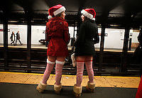 People dressed as santa claus wait for the subway station while they take part during the SantaCon party in New York, United States. 15/12/2012. Photo by Kena Betancur/VIEWpress.