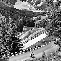 Descending Umbrail Pass, which connects with the Passo dello Stelvio above the town of Santa Maria Val Müstair, Switzerland. Santa Maria Val Müstair is a village in the Val Müstair municipality in the district of Inn in the Swiss canton of Graubünden.