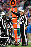 29 November 2009: NFL Referee Jeff Triplette signals a first down after a measurement is made during a game between the Miami Dolphins and the Buffalo Bills at Ralph Wilson Stadium in Orchard Park, New York. The Bills defeated the Dolphins 31-14. Mandatory Credit: Ed Wolfstein Photo