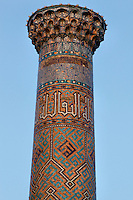 """Detail of minaret, Sher-Dor Madrasah, 1619-36, Samarkand, Uzbekistan, pictured on July 15, 2010, in the afternoon. The Sher-Dor Madrasah, commissioned by Yalangtush Bakhodur as part of the Registan ensemble, and designed by Abdujabor, takes its name, """"Having Tigers"""", from the double mosaic (restored in the 20th century) on the tympans of the portal arch showing suns and tigers attacking deer. Samarkand, a city on the Silk Road, founded as Afrosiab in the 7th century BC, is a meeting point for the world's cultures. Its most important development was in the Timurid period, 14th to 15th centuries. Picture by Manuel Cohen."""