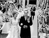 """Washington, DC - June 12, 1971 -- United States President Richard M. Nixon, right, and first lady Pat Nixon, left, give the """"A-OK"""" sign as they walk down the aisle of the Rose Garden at the White House in Washington, D.C. after their daughter Tricia's wedding on Saturday, June 12, 1971.  More than 400 friends and guests braved intermittent rain to attend the ceremony..Credit: Pool via CNP"""