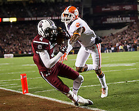 The tenth ranked South Carolina Gamecocks host the 6th ranked Clemson Tigers at Williams-Brice Stadium in Columbia, South Carolina.  USC won 31-17 for their fifth straight win over Clemson.  South Carolina Gamecocks wide receiver Shaq Roland (4) catches a touchdown pass over Clemson Tigers defensive back Bashaud Breeland (17)