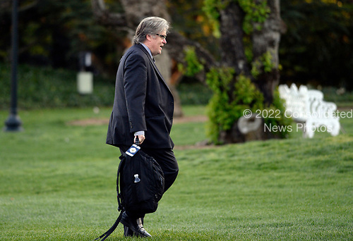 Steve Bannon, advisor to United States President Donald Trump walks on the South Lawn after arriving at the White House in Washington, DC, April 9, 2017.<br /> Credit: Olivier Douliery / Pool via CNP