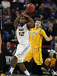 Northern Iowa's Marvin Singleton (12) looks to pass after grabbing a rebound against Wyoming's Riley Grabau (2) during the 2015 NCAA Division I Men's Basketball Championship March 20, 2015 at the Key Arena in Seattle, Washington.   Northern Iowa beat Wyoming 71 to 54.   ©2015.  Jim Bryant Photo. All Rights Reserved.