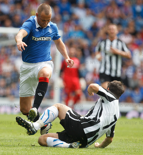 Kenny Miller jumps over the challenge from Joey Barton