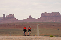 Muriel Garven, left, and son Robert, of Saskatoon, Saskatchewan, descend toward Monument Valley Navajo Tribal Park, rear, on the Utah-Arizona border. The Red Rock Canyons Tour, organized by Lizard Head Cycling Tours, wound through 400 miles of the desert southwest. The route traveled through canyons and national monuments in Colorado, Utah and Arizona, ending at Lake Powell. (Kevin Moloney for the New York Times)