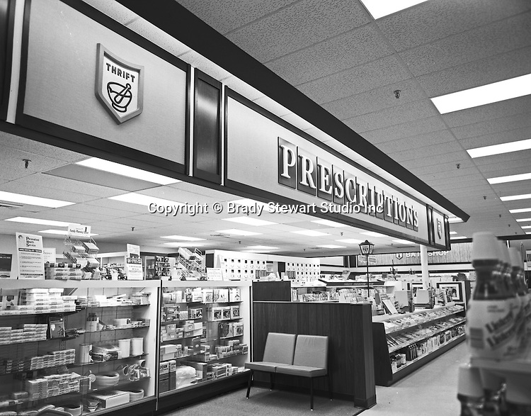 Pittsburgh PA:  On location photography  of a Thrift Drug Store.  Thrift Drug was founded in 1937 and eventually purchased by JC Penny Corp in 1968.  Thrift Drug was a merchandising pickup center for the JC Penny Catalog.