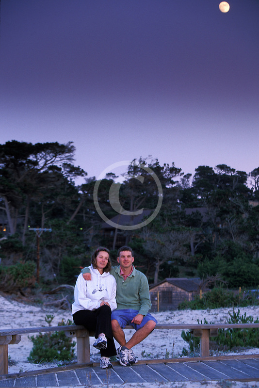 California, Pacific Grove, Asilomar State Beach, couple at sunset