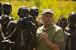 Art Wolfe interacts with some of the Surma tribesmen in Ehiopia.