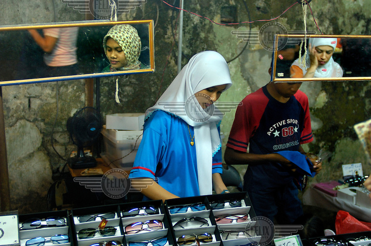 Stall selling sunglasses at the downtown Saturday night Pasar Malam (night market) close to Little India and Jalan Tunku Abdul Rahman.