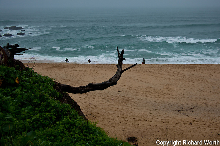 Surfer's  hit Montara State Beach south of San Francisco on the first day of a predicted week's worth of winter storms.