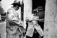 Lower East Side April, 1973. New York City Firemen in action.