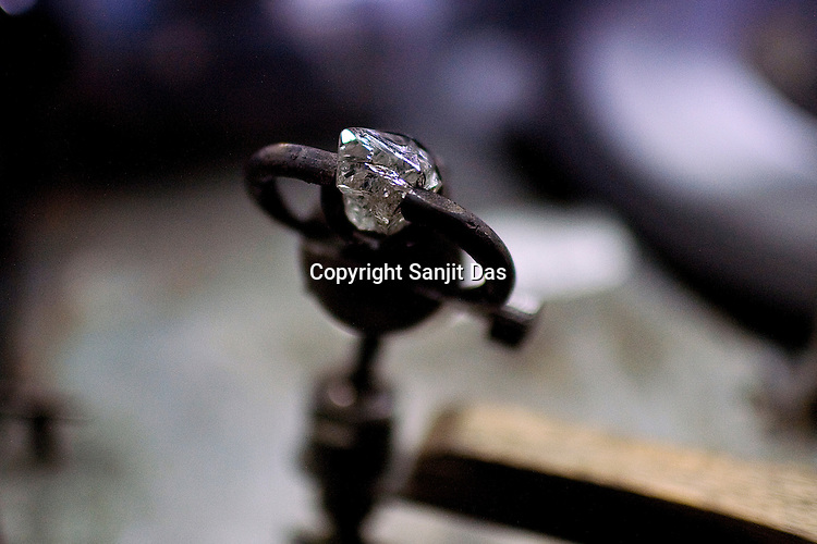 A rough cut diamond is seen at the diamond cutting and polishing factory in Surat, Gujarat, Western India.