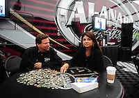 Jun. 19, 2011; Bristol, TN, USA: NHRA top fuel dragster driver Del Worsham (left) and wife Connie Worsham do a puzzle during a rain delay to eliminations at the Thunder Valley Nationals at Bristol Dragway. Mandatory Credit: Mark J. Rebilas-