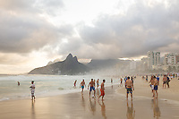 People playing football on Ipanema beach in Rio de Janeiro