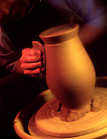 design concept business creation, molding, form, building, construction. Pottery making craftsman puts finishing touch on clay pot.