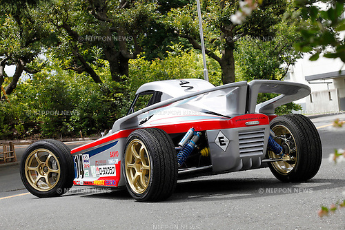 August 10, 2010 - Tokyo, Japan -  The EV Sports Concept HER-02, that employs a 15-kilowatt-hour Sanyo lithium ion battery pack and a new AC Propulsion drive system, is displayed at the Yokohama Rubber Co., Ltd. Hiratsuka factory, Tokyo, Japan, on August 10, 2010. Veteran off-road Japanese driver Ikuo Hanawa piloted the electric buggy up the 12.5-mile course of the Pikes Peak International Hill Climb on Sunday, June 27, in the state Colorado, U.S.A,  with a time of 13:17.575 that shattered the previous electric vehicle record. (Photo Laurent Benchana/Nippon News)