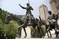 "Spain. Province of Madrid. Madrid. Plaza (Place) Espana. Statues of Don Quijote de la Mancha and his companion Sancho Panza. ""The Ingenious Hidalgo Don Quixote of La Mancha"" is an early novel written by Spanish author Miguel de Cervantes Saavedra. The protagonist, Alonso Quixano, is a landowner who has read so many stories of chivalry that he descends into fantasy and becomes convinced he is a knight errant. Together with his companion Sancho Panza, the self-styled Don Quixote de la Mancha sets out in search of adventures. Horse and donkey. Downtown. Town center.  © 2007  Didier Ruef"