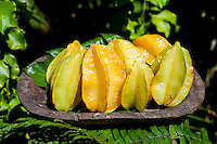 Carambola or star fruit in a wooden bowl at Tauono's Plantation, Aitutaki Island, Cook Islands.