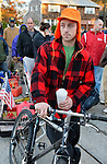Nov. 3, 2012 - Merrick, New York, U.S. - JOHN GIBSON (wearing orange hat), of Merrick, rode a bicycle cart to take gas containers to fill at the Merrick Hess station, one of the Long Island gas stations still open the Saturday after Hurricane Sandy brought severe damage to this south shore area. U.S. Army National Guard members from Syracuse are there to help Nassau County police make sure order is kept. About 500,000 of the 1.2 million Long Islanders who lost power still don't have it, and the area continues to suffer from severe damage from floods and wind. The Freeport Armory in the next town was supposed to have free gas, up to 10 gallons for each car, this day, but people who showed up there were turned away.