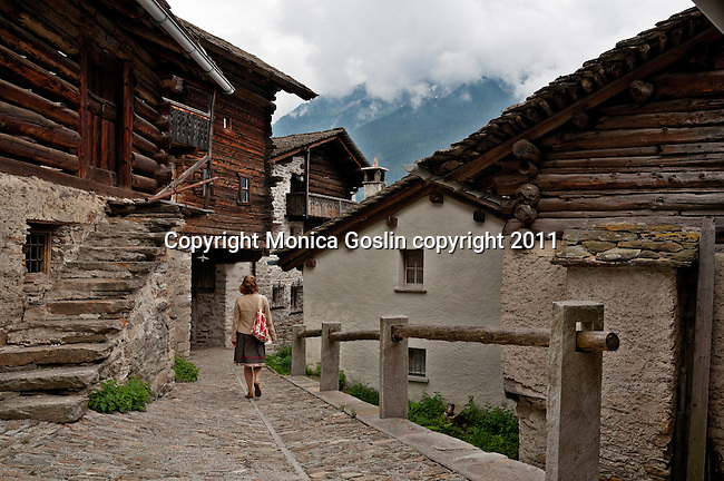 Slate roofs, houses, barns, and stone roads in Soglio, Switzerland a town the Bregaglia Valley which dates back to 1219 and is said to be one of the most picturesque towns in Switzerland; Graubunden Canton