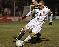 Casey Townsend #11 of the University of Maryland shields the ball from Matt Smallwood #22 of Penn State during an NCAA 3rd. round match at Ludwig Field, University of Maryland, College Park, Maryland on November 28 2010.Maryland won 1-0.