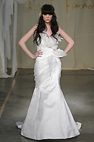 Model walks runway in a White Cedar wedding dress by Carol Hannah Whitfield, for the Carol Hannah Spring Summer 2012 Bridal collection runway show.
