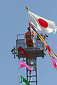 TOKYO - JANUARY 06: Aerial ladder units perform a demonstration during the New Year's fire review conducted by the Tokyo Fire Department at Tokyo Big Sight on January 6, 2010 in Tokyo, Japan. The annual event, featuring various demonstrations of the latest firefighting and emergency rescue techniques, aims to promote the prevention of fire and disaster. About 2,700 professional firefighters and members of community-based fire companies in Tokyo and 137 fire vehicles, helicopters and ships were mobilized for the annual demonstration. (Photo by Laurent Benchana/Nippon News)