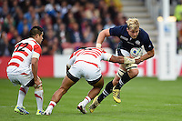 David Denton of Scotland takes on the Japan defence. Rugby World Cup Pool B match between Scotland and Japan on September 23, 2015 at Kingsholm Stadium in Gloucester, England. Photo by: Patrick Khachfe / Onside Images