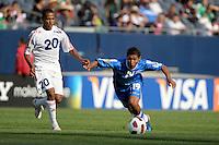 El Salvador's Reynaldo Hernandez plays the ball in front to Cuba's Alberto Gomez.  El Salvador defeated Cuba 6-1 at the 2011 CONCACAF Gold Cup at Soldier Field in Chicago, IL on June 12, 2011.