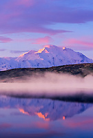 Mount McKinley, (Denali) North America's highest mountain, morning alpenglow touches peak of mountain, fog over wonder lake reflection autumn, Denali National Park, Alaska
