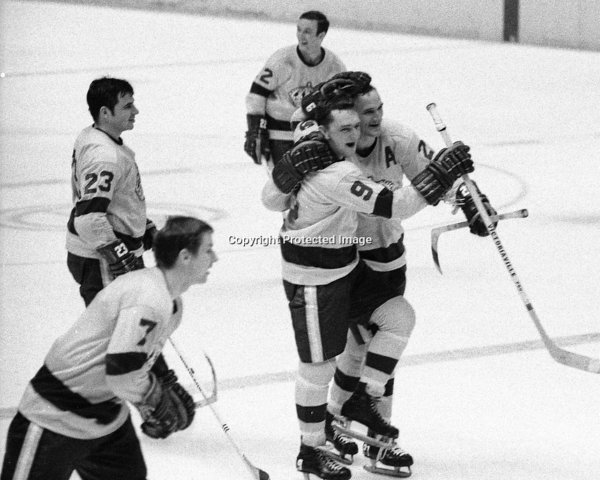L.A. Kings celebrate win against the Seals, Bill White, Real Lemieux, Eddie Joyal, Mike Byers, and Skip Krake.(1969 photo)