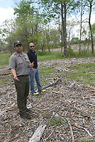 NWA Democrat-Gazette/FLIP PUTTHOFF <br /> Nolan Moore (left) and Tanner Bedwell look at a plot       April 2017    where cedar trees were removed recently to allow native grasses to flourish