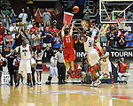 "Illinois State's Nic Moore (11) shoots vs. Ole Miss' Murphy Holloway (31) in a National Invitational Tournament game at the C.M. ""Tad"" Smith Coliseum in Oxford, Miss. on Wednesday, March 14, 2012. Illinois State won 96-93 in overtime. (AP Photo/Oxford Eagle, Bruce Newman)"