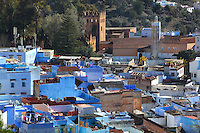 The town of Chefchaouen with its 15th century Kasbah and Grande Mosquee, in the Rif mountains of North West Morocco. The Kasbah or fortress served as military camp, seat of power and rulers residence and was used by Ali Ibn Mousa Ibn Rashid in his jihad against the Portuguese. It is surrounded by a wall with 11 defensive towers and a 4-storey watchtower and contains a garden of orange, jasmine and palm trees. It now houses an art gallery and ethnography museum. The Grande Mosquee or El Masjid El Aadam was built adjoining the kasbah by the son of the town's founder, Ali Ben Rashid. It has longitudinal naves, a prayer hall with 4 gates and an octagonal minaret typical of the region. Chefchaouen was founded in 1471 by Moulay Ali Ben Moussa Ben Rashid El Alami to house the muslims expelled from Andalusia. It is famous for its blue painted houses, originated by the Jewish community, and is listed by UNESCO under the Intangible Cultural Heritage of Humanity. Picture by Manuel Cohen