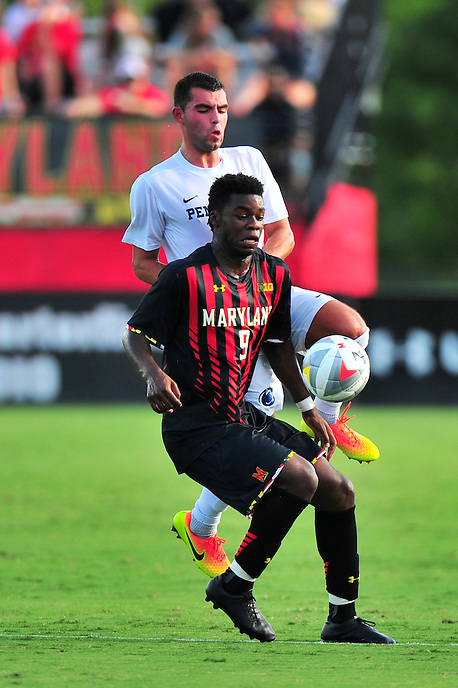 Terrapins Sebastian Elney shields the ball from his opponent. Maryland defeated Penn State in over time 3-2 during an NCAA D-1 soccer match at Ludwig Field in College Park, MD on Sunday, September 18, 2016.  Alan P. Santos/DC Sports Box