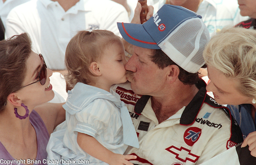 Dale Earnhardt gets a victory kiss from daughter Taylor Nicole after winning the Pepsi 400 at Daytona International Speedway in July 1990.(Photo by Brian Cleary/www.bcpix.com)