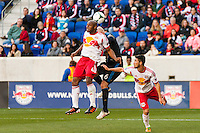 Jamison Olave (4) of the New York Red Bulls goes up for a header with Conor Casey (6) of the Philadelphia Union. The New York Red Bulls defeated the Philadelphia Union 2-1 during a Major League Soccer (MLS) match at Red Bull Arena in Harrison, NJ, on March 30, 2013.