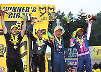 Oct 2, 2016; Mohnton, PA, USA; (From left) NHRA pro stock driver Vincent Nobile , pro stock motorcycle rider Eddie Krawiec , funny car driver Tommy Johnson Jr and top fuel driver Antron Brown celebrate after winning the Dodge Nationals at Maple Grove Raceway. Mandatory Credit: Mark J. Rebilas-USA TODAY Sports