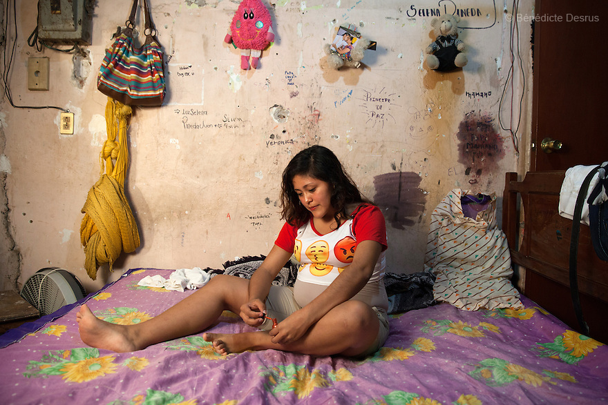 "Luz Selena Pineda Juan at her home in Juchitán, Oaxaca, Mexico on February 16, 2016. Luz is 16-year-old and is seven months pregnant. The daughter of a local evangelical church representative, who refused to allow her out to teenage parties, she lives at home with her family in a working-class neighbourhood of Juchitán in the southern Mexican state of Oaxaca. Though she knows about contraception, she did not use it - she became pregnant after forgetting to take the morning-after pill. Her baby's father was married but has left his wife and 3-year-old daughter and Luz hopes they will be able to get married one day. She dropped out of school even before becoming pregnant and has no firm plans for her future. She is going to call her baby ""Soid"" – the Spanish word for God, spelled backwards. While Mexico has outlawed marriage under the age of 18, many young girls become unofficial wives and mothers much earlier. In Juchitán, teenage pregnancy is expected, even prized. Mexico ranks first in teenage pregnancies among the member countries of the Organization for Economic Co-operation and Development (OECD). Photo by Bénédicte Desrus"